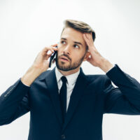 handsome-business-guy-with-mobile-phone-worried_23-2147580190